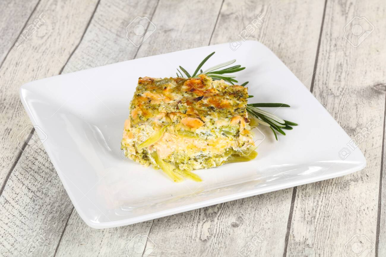 Tasty casserole with salmon and broccoli served rosemary - 147830300