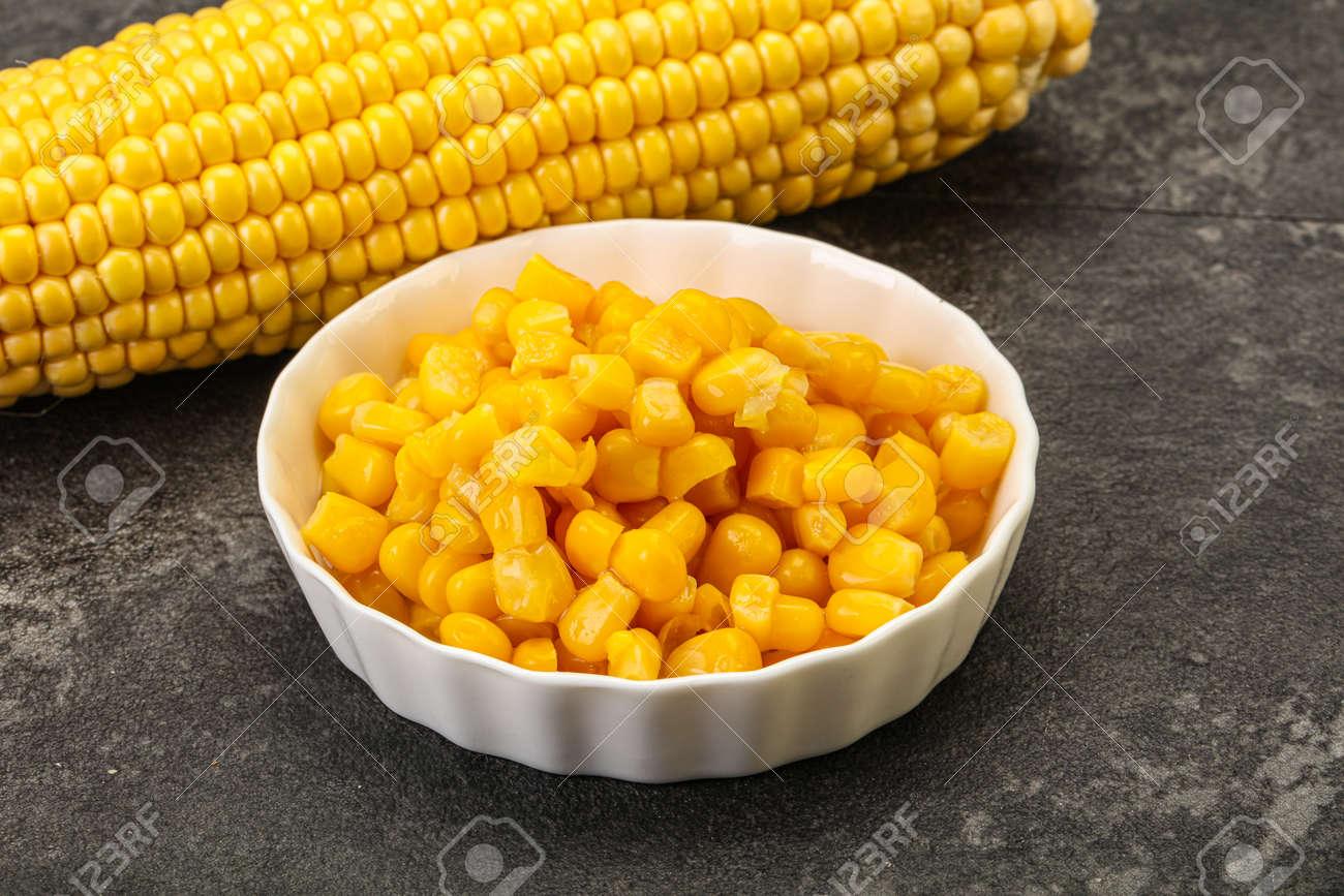 Sweet yellow corn grain in the bowl - 167470546