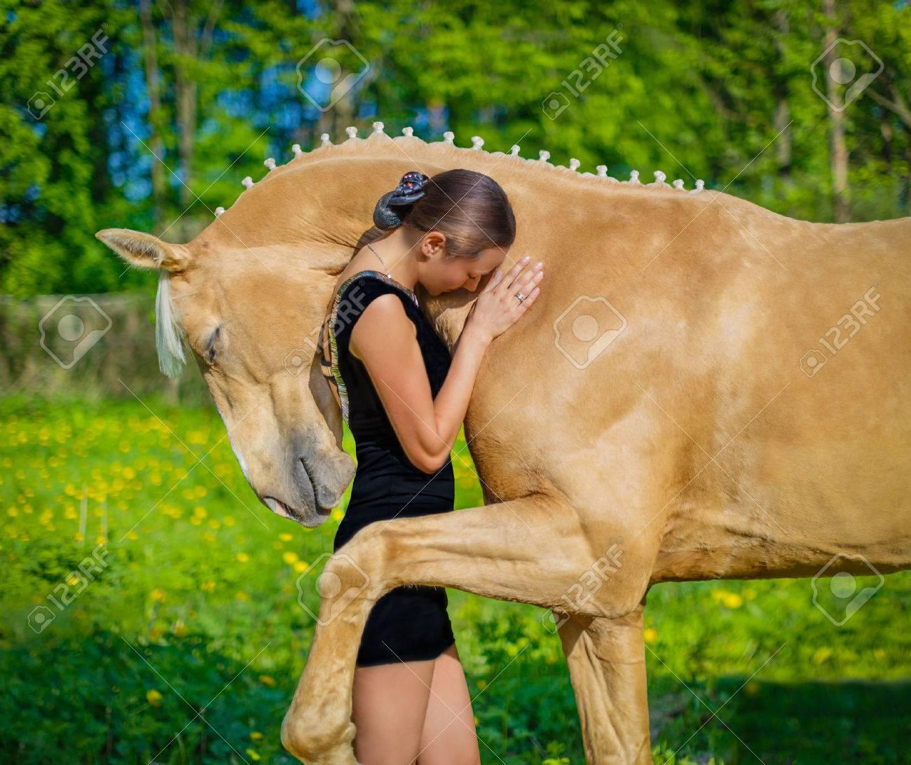 Girl hugging a horse - 40401762