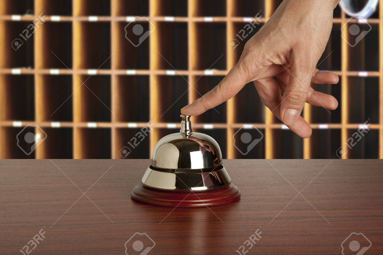 Hand of a woman using a hotel bell Stock Photo - 11994124