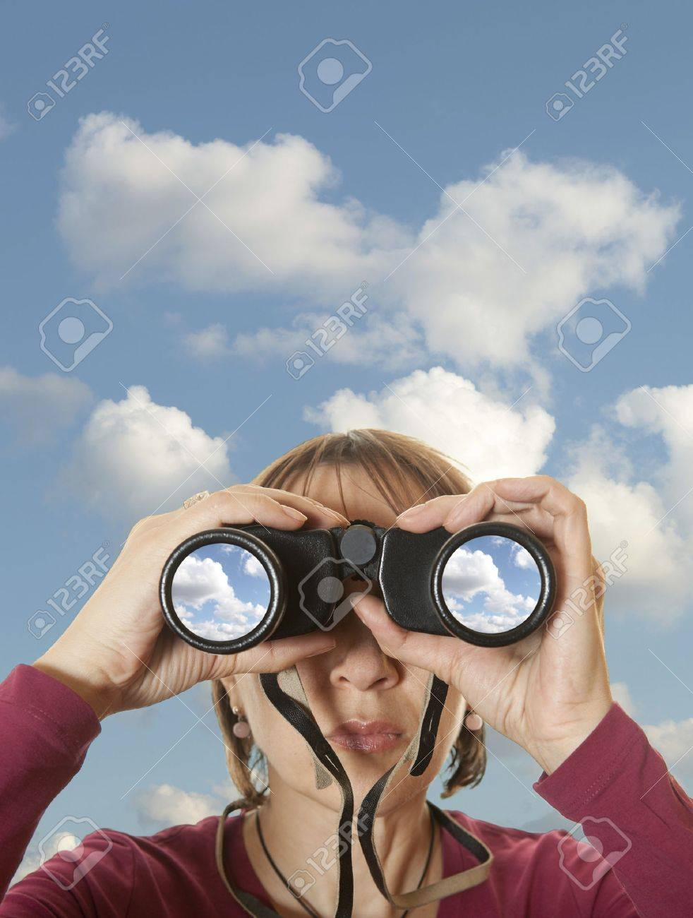 Attractive woman with binoculars in the sky - 16643345