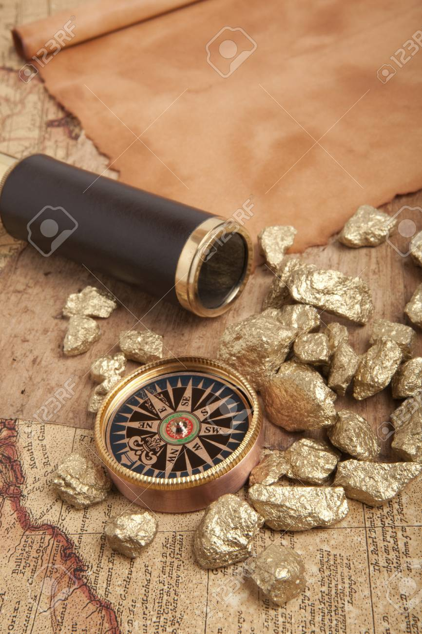 Gold nuggets and vintage brass telescope on antique map Stock Photo - 17542316