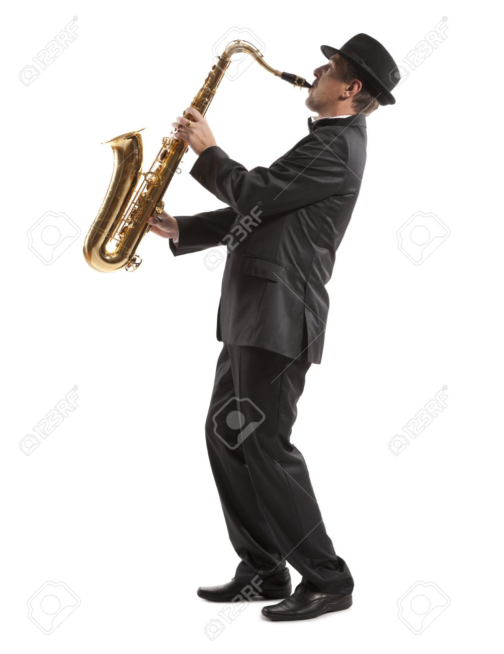 Saxophonist. Middle aged man playing on saxophone isolated on background Stock Photo - 19225134