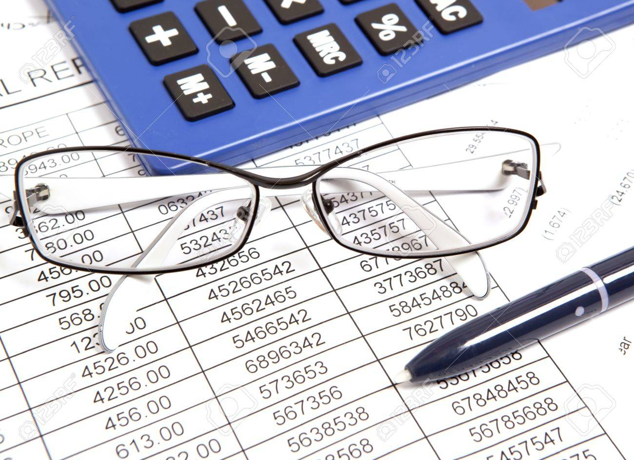 Glasses And Calculator On Paper Table With Finance Report Stock ...