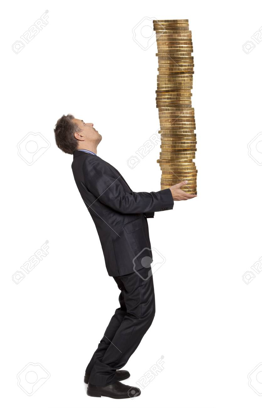 Businessman holding a stack of golden coins Stock Photo - 24525829