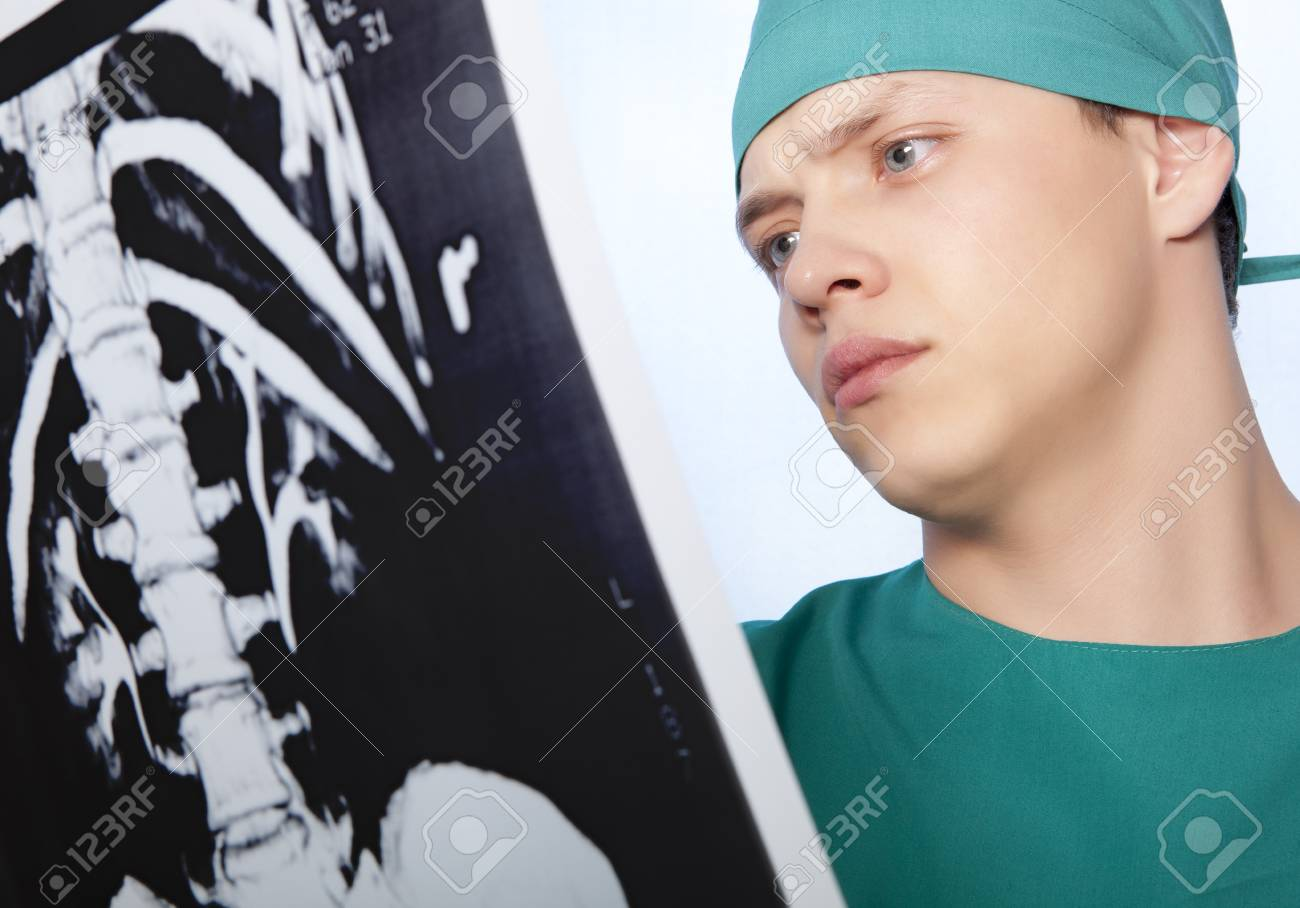 Male doctor looking at an X-ray spine Stock Photo - 26641294