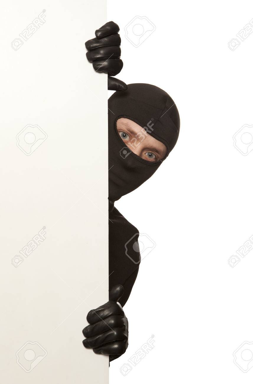 Ninja. Robber hiding behind a empty white sign with space for text. Isolated on white background - 37616807