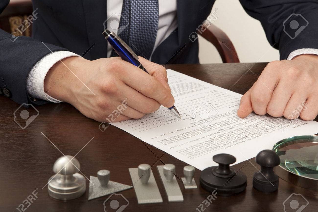 Lawyer, notary signs the documents from our office - 38258629