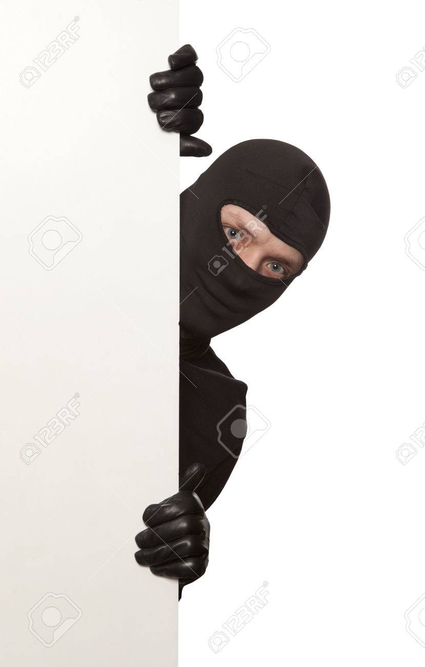 Ninja. Robber hiding behind a empty white sign with space for text. Isolated on white background - 38250477