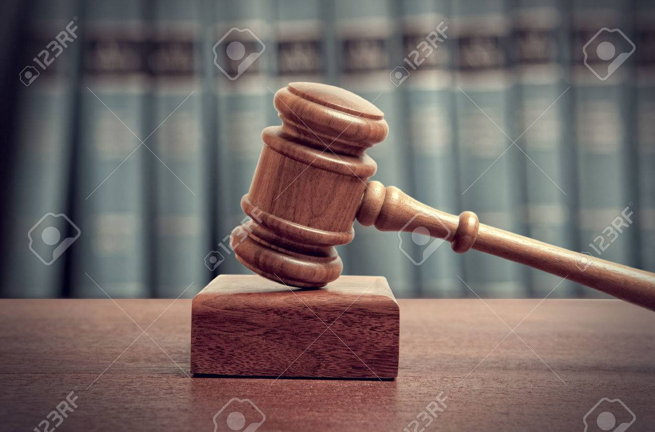 The gavel of a judge in court - 45327322