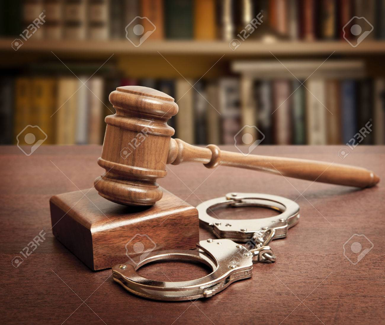 Gavel and handcuffs on wooden background - 49176695