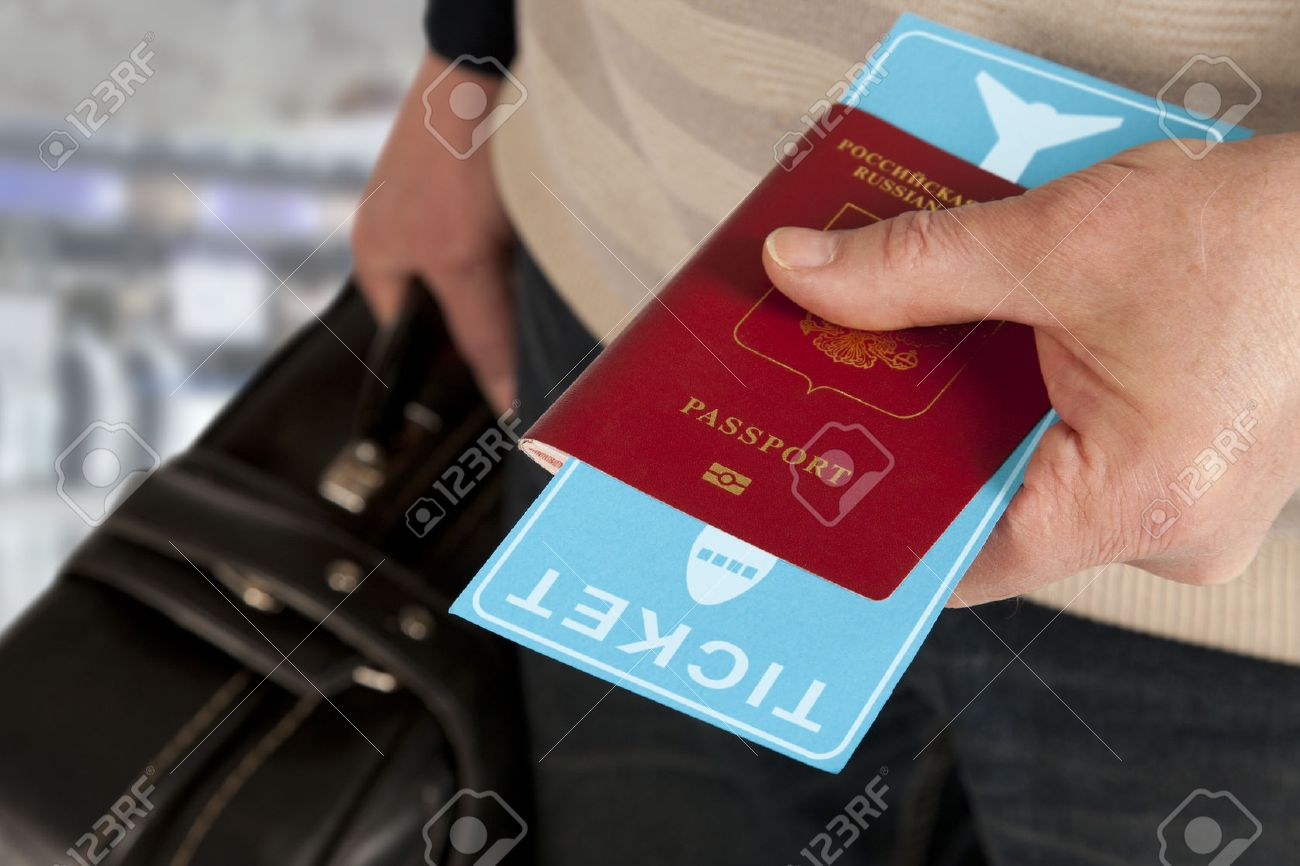Customs control. Passport and ticket in hand in airport - 50363840
