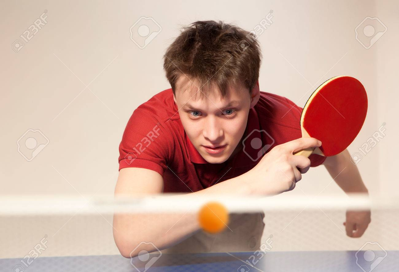 Young man playing table tennis - 52625911