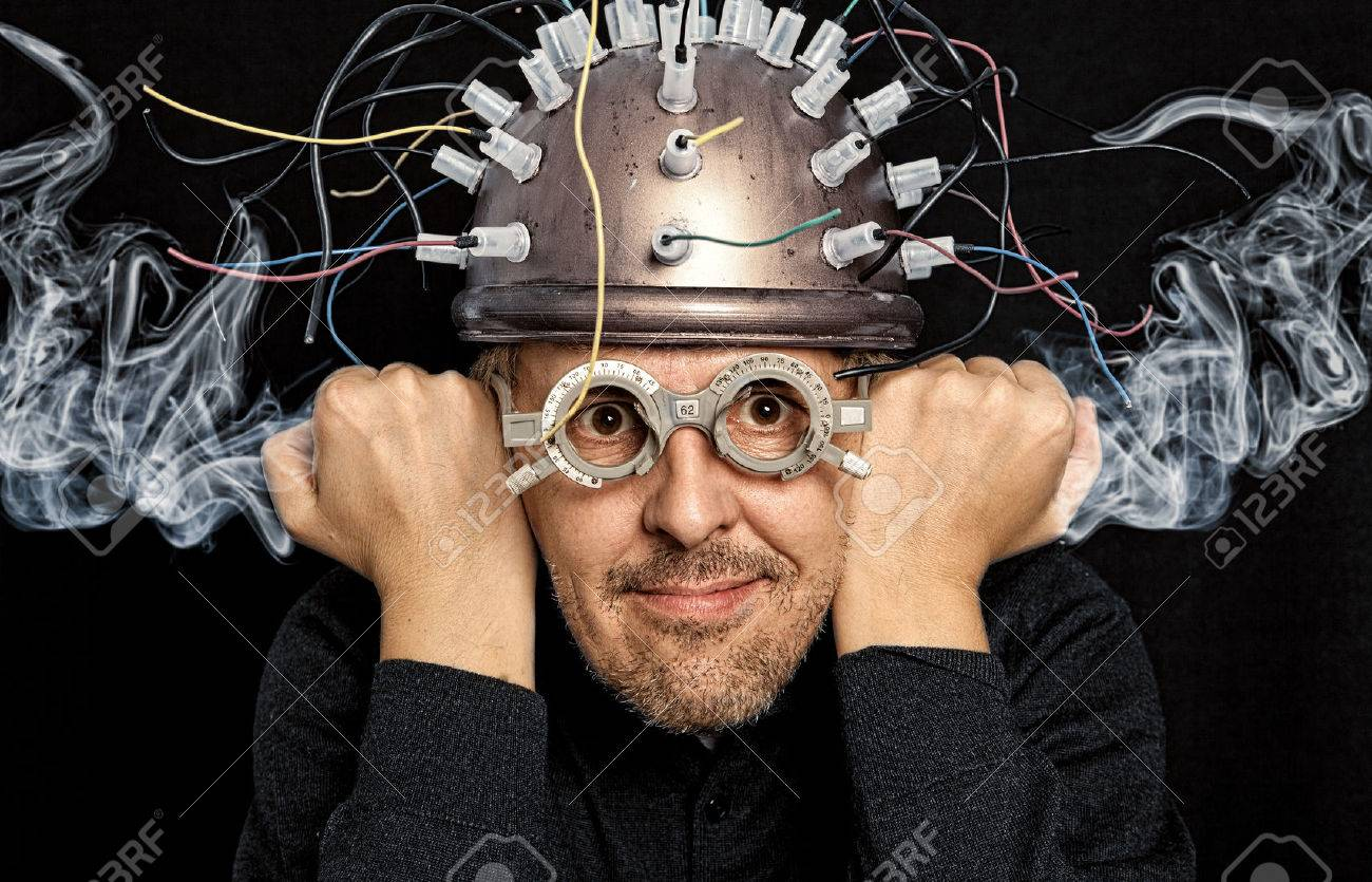 Crazy inventor with helmet for brain research - 52626005