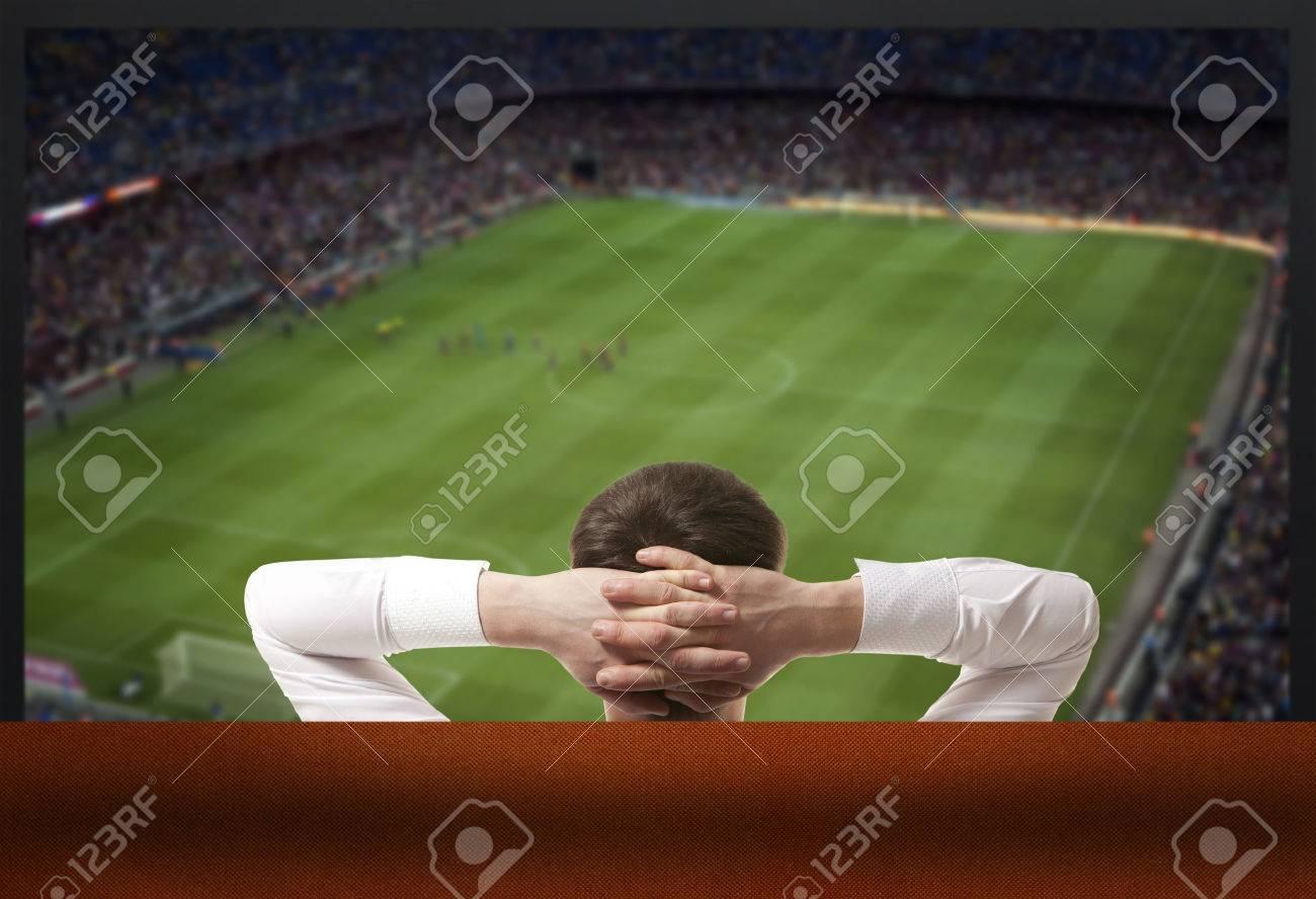 Soccer fan watching the TV - 57752914