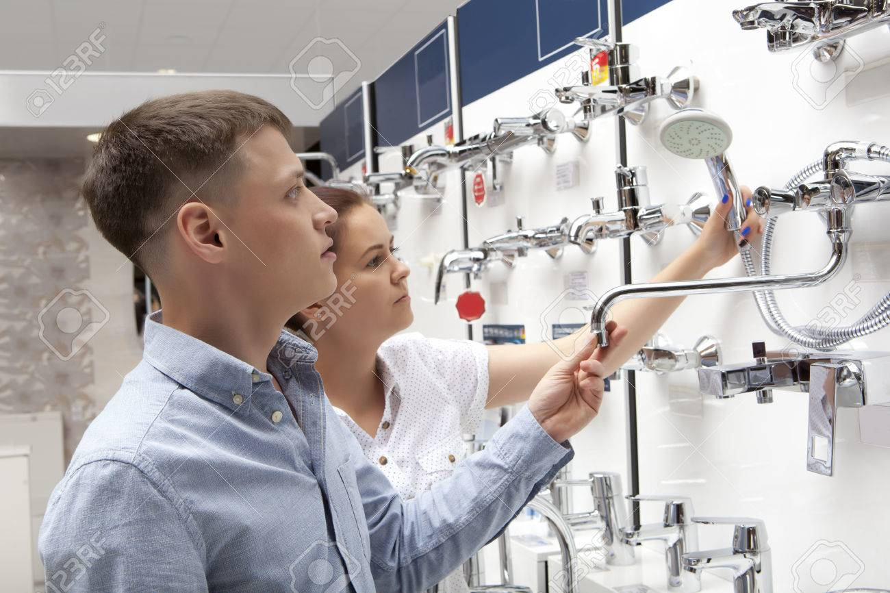 Couple shopping for bathroom equipment in hardware store, shop for construction - 59607743