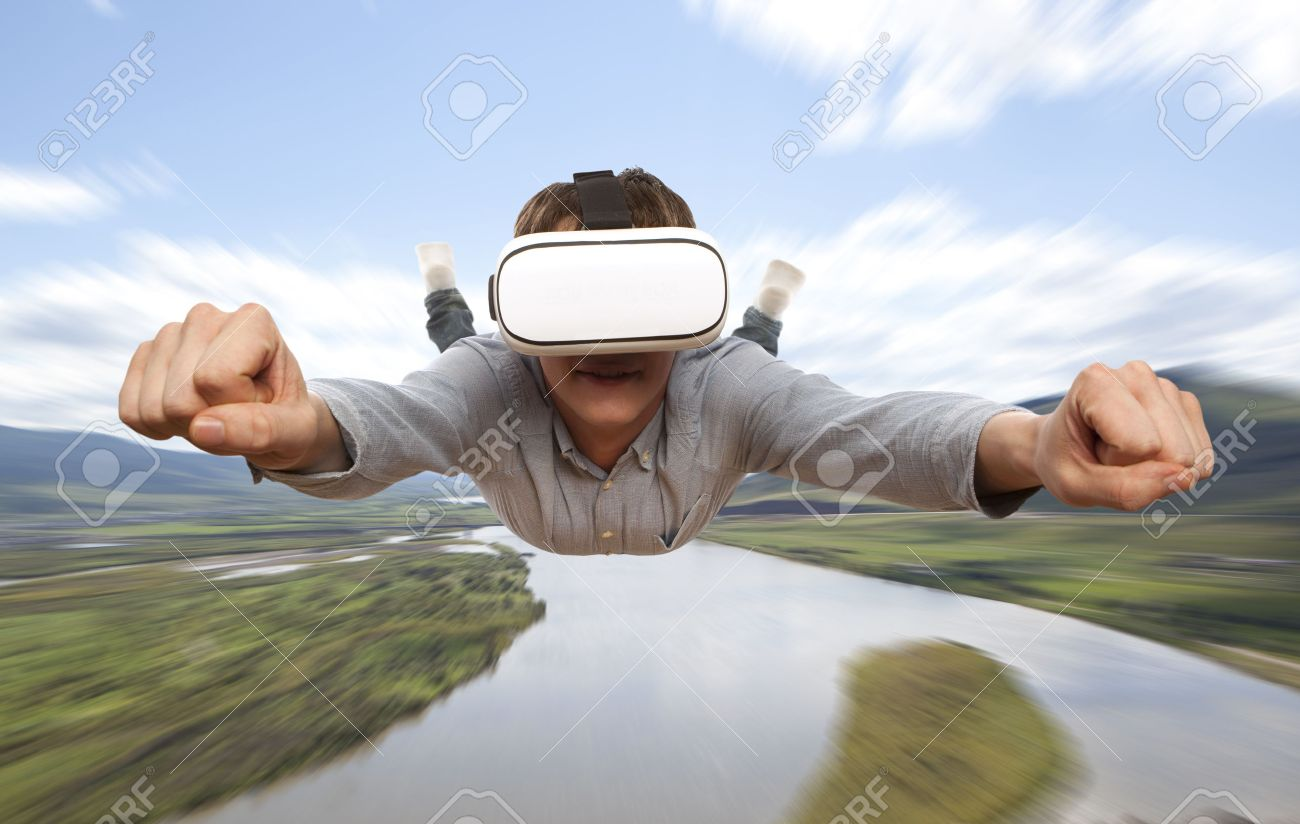 Young man wearing virtual reality glasses flies over nature - 64184136