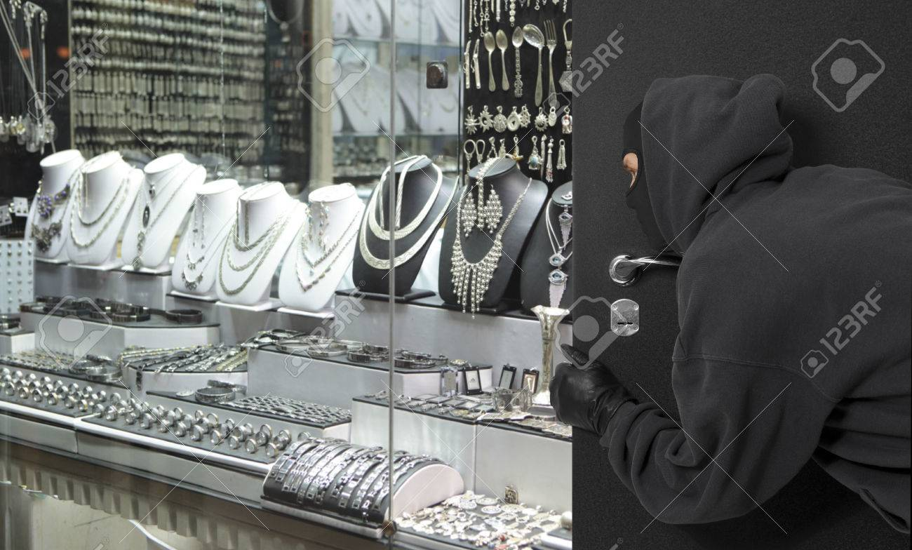Man wearing a mask robbed a jewelry store. Robbery concept - 66081736