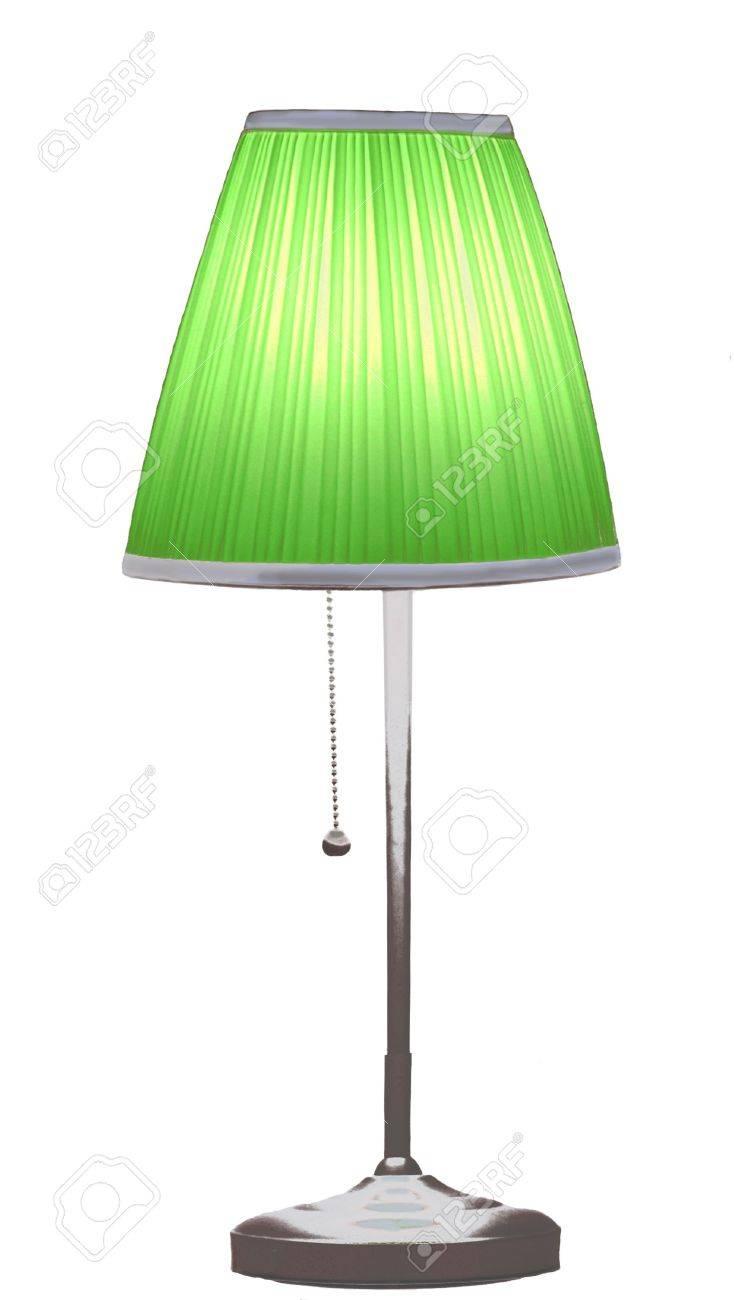 desk lamp in a green lamp shade stock photo