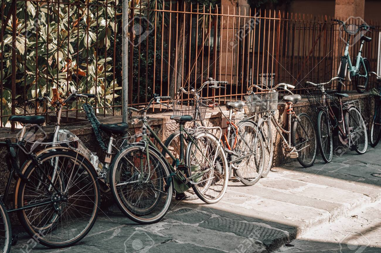 Florence street is full of bicycles. Tourism and travel concept. Mixed media - 142927129