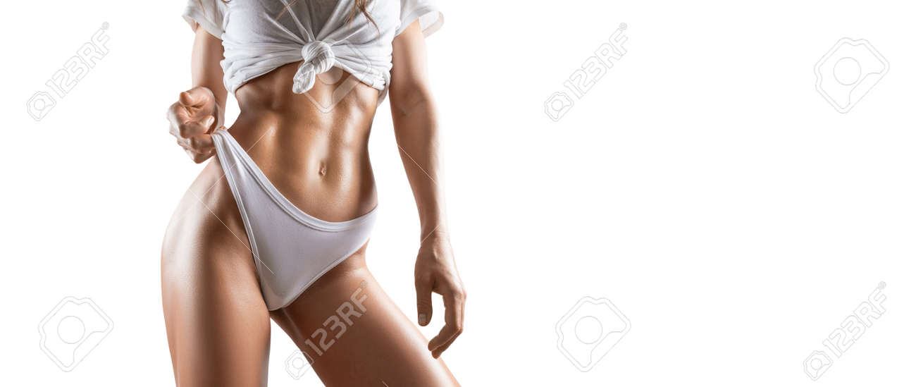 Image of a pumped up abs. Beautiful sportive woman posing in studio on a white background. Fitness, bodybuilding, aerobics concept. Mixed media - 167280036