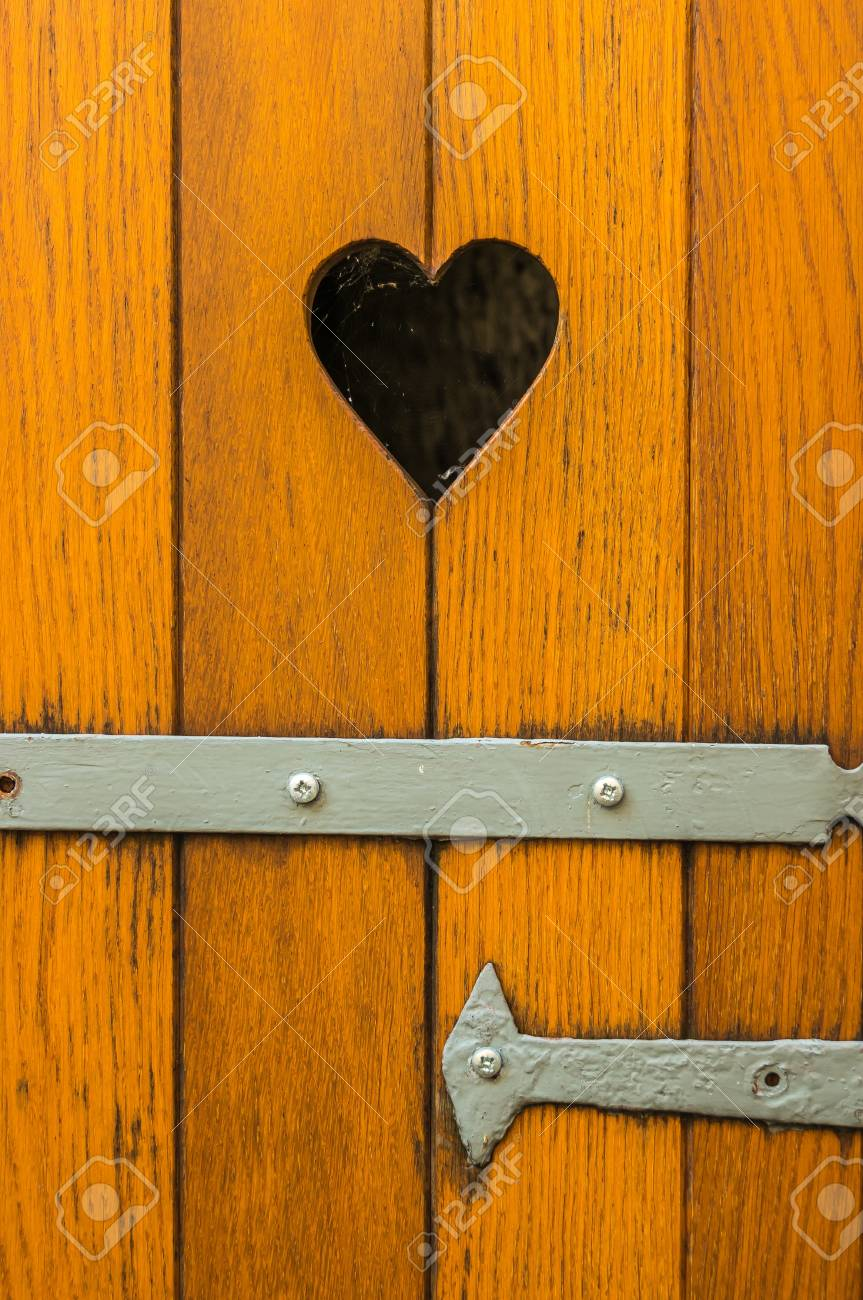 Old wooden door with heart decoration in Lindau Stock Photo - 73507337