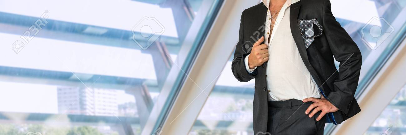Disheveled man in black suit in office Stock Photo - 73493760