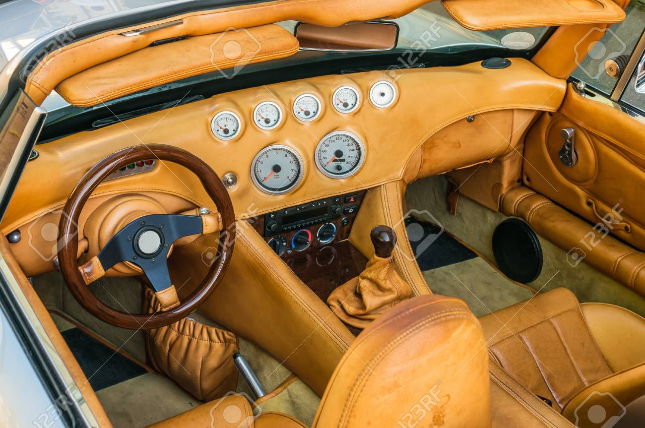 Steering wheel, shift lever and dashboard inside the luxury car Stock Photo - 73507806