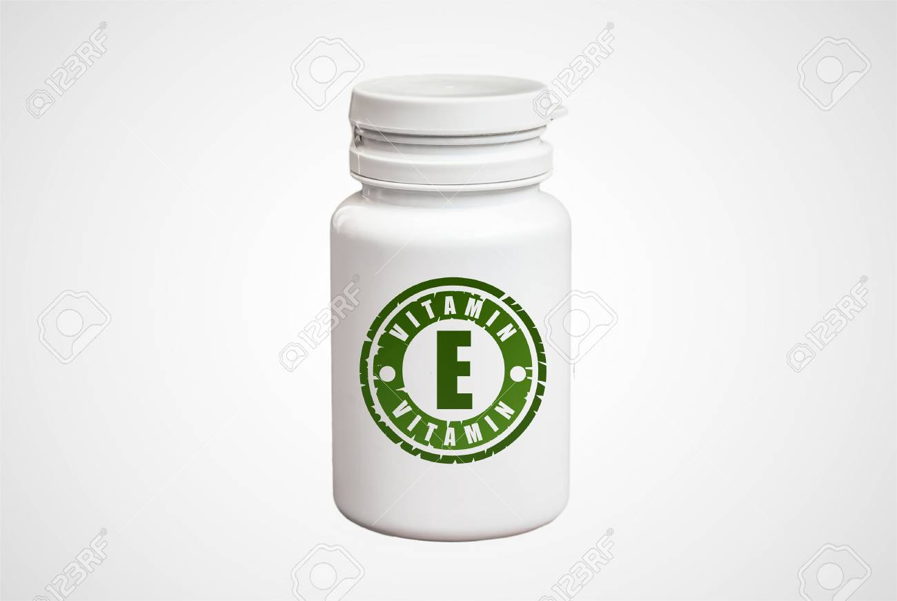 Bottle of pills with vitamin E on white background Stock Photo - 73494213