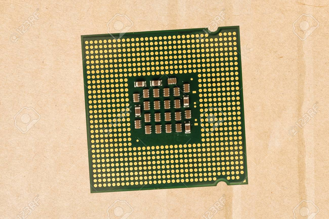 Computer processor chip (CPU) isolated on carton background Stock Photo - 73494502