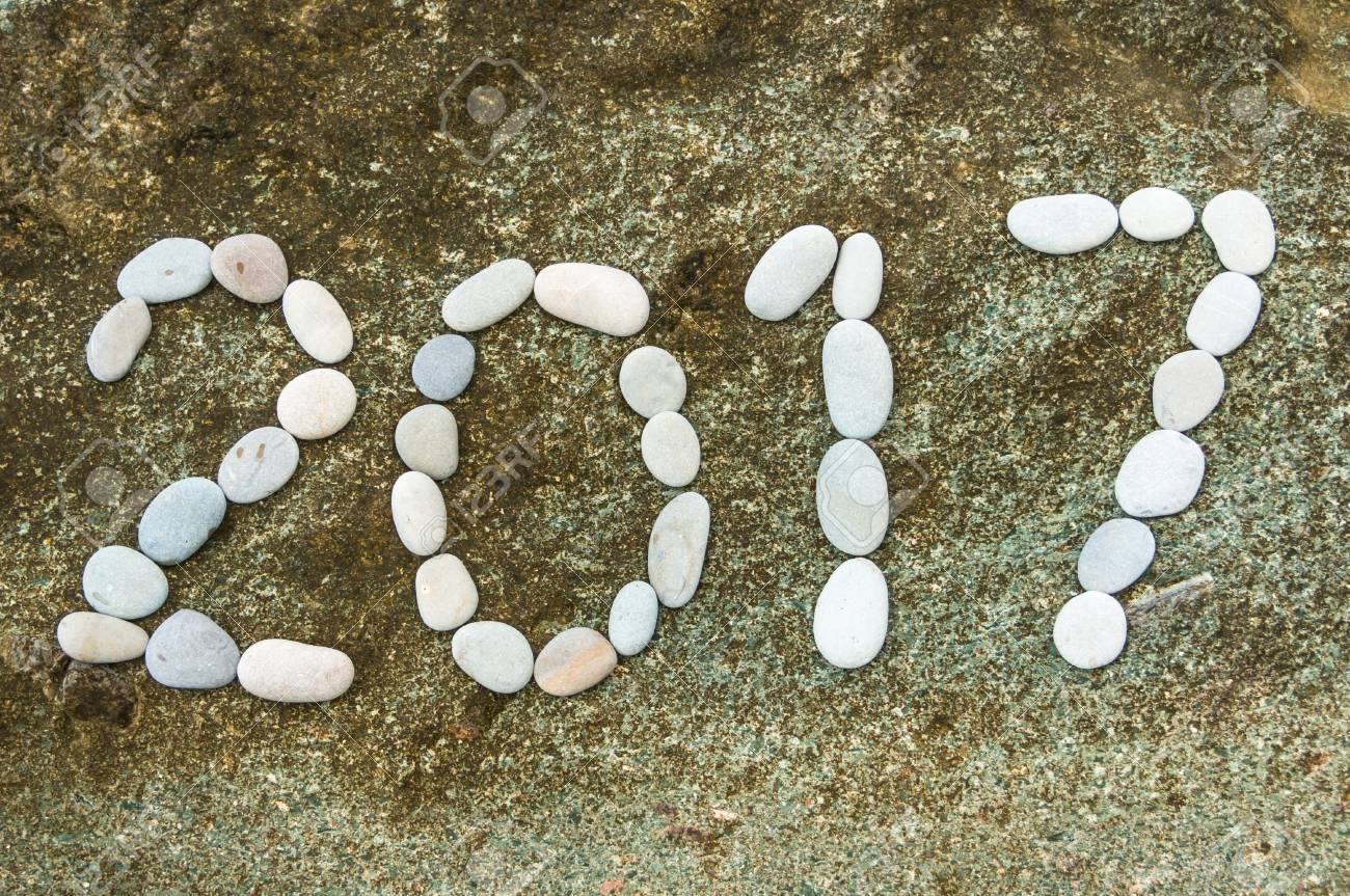 Number 2017 on beach, holiday background Stock Photo - 73525832