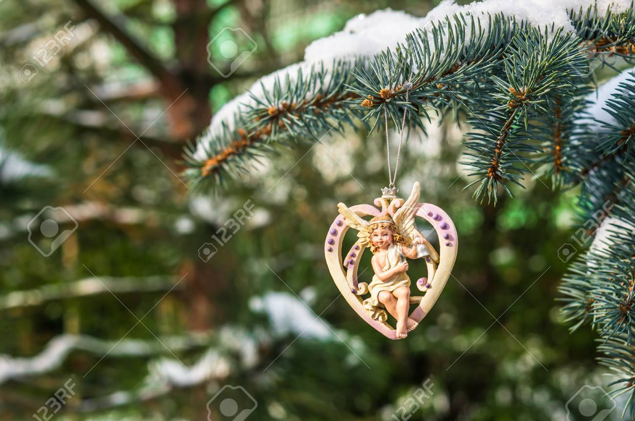 Christmas Heart With Angel On Snowy Christmas Tree Branch Stock