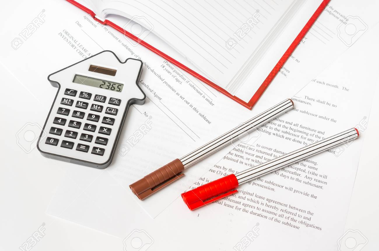 Calculator and contract on table - seal, lease, purchase and