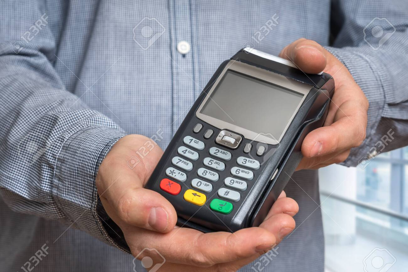 Payment terminal in hand of man - bank money transfer concept - 149340270