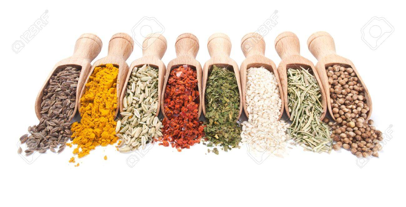 Row of wooden shovels with spices scattered from them Stock Photo - 12783253
