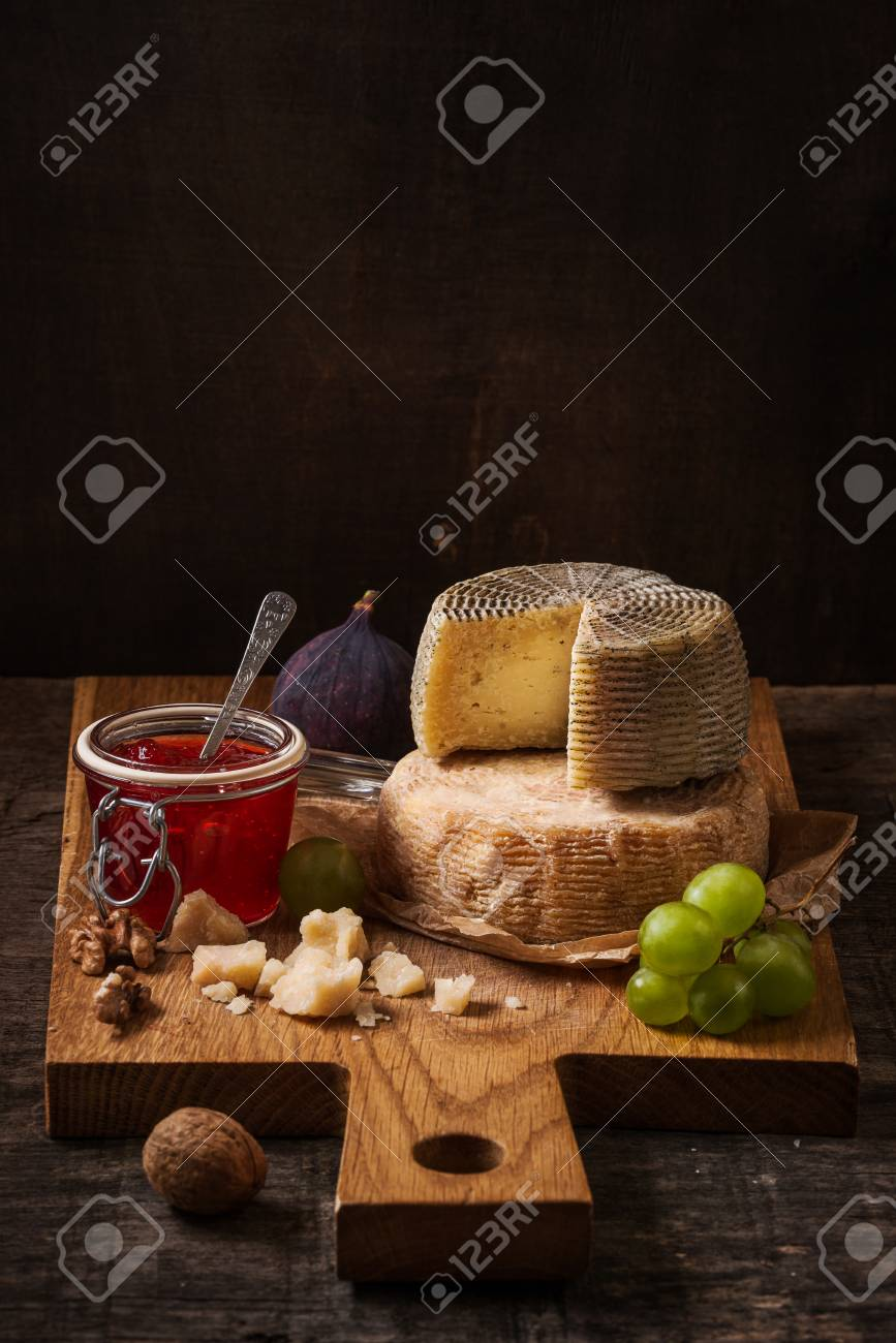Dark Still Life With Cheese Board Fruits And Wine On The Rough