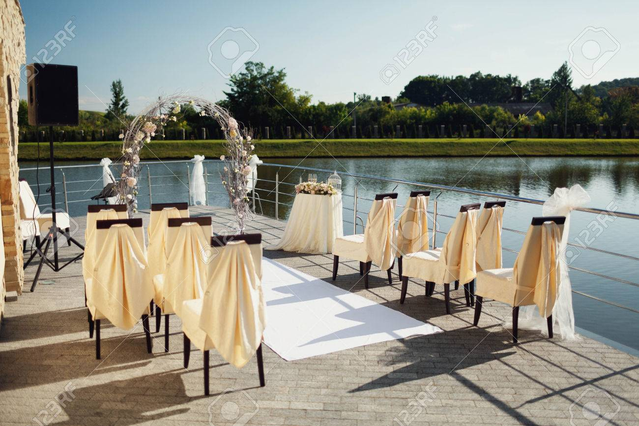 Stock Photo - wedding arch with chairs and many flowers and decor & Wedding Arch With Chairs And Many Flowers And Decor Stock Photo ...