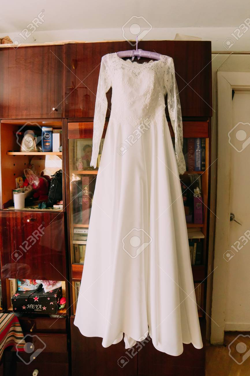 Excellent Expensive Wedding Dress Hanging In The Interior Stock ...