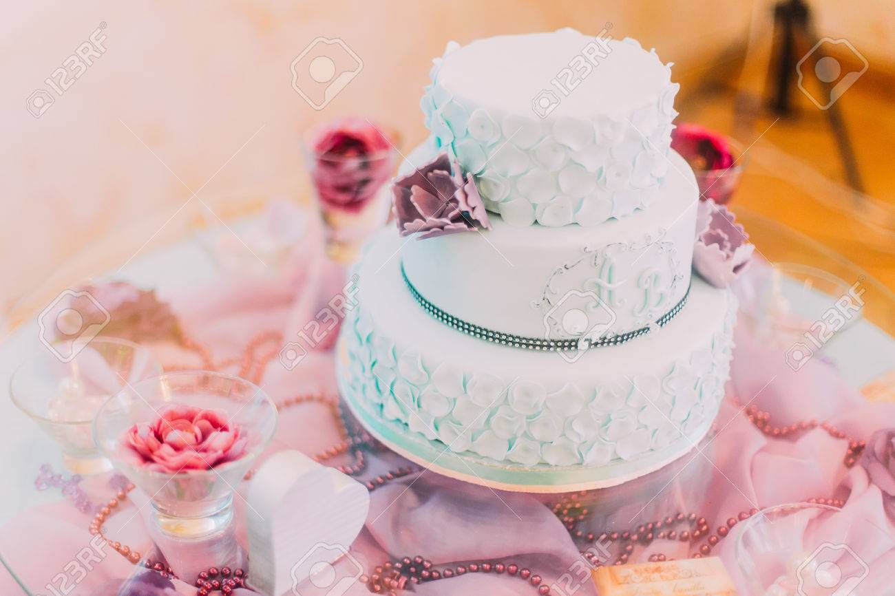 Blue And White Wedding Cake Decorated With Violet Flowers. Stock ...