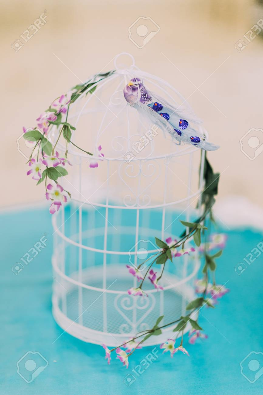 Close Up Of Beautiful Decorative Birdcage With Some Cute Flowers