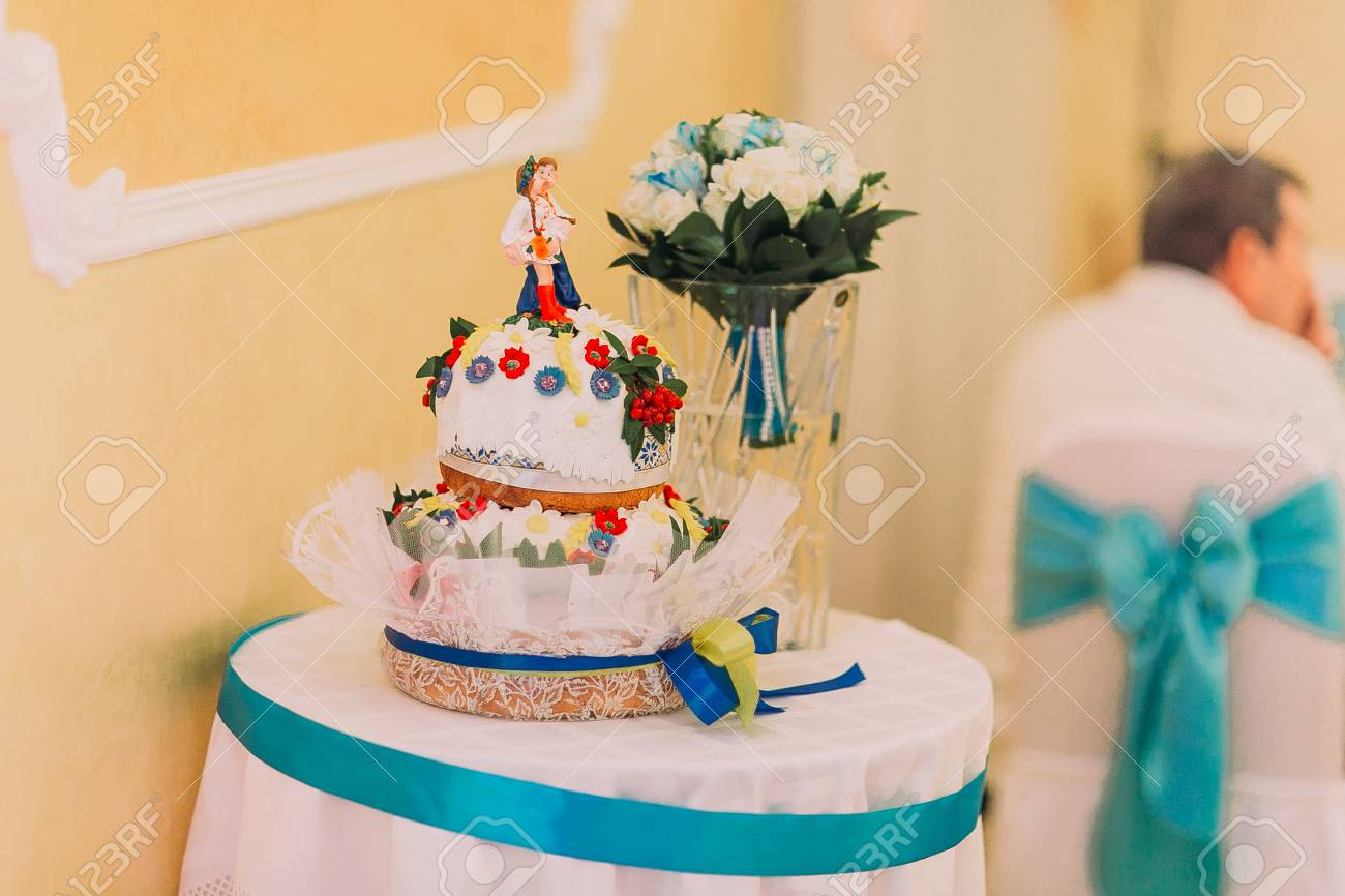 Beautiful Ethnic Style Wedding Cake On Table With Floral Bouquet ...