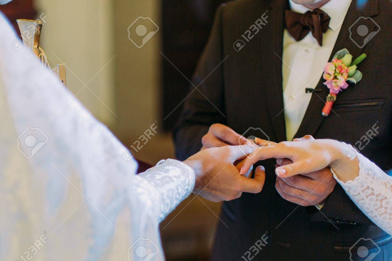 Priest Is Putting The Ring On Brides Finger During Orthodox Stock
