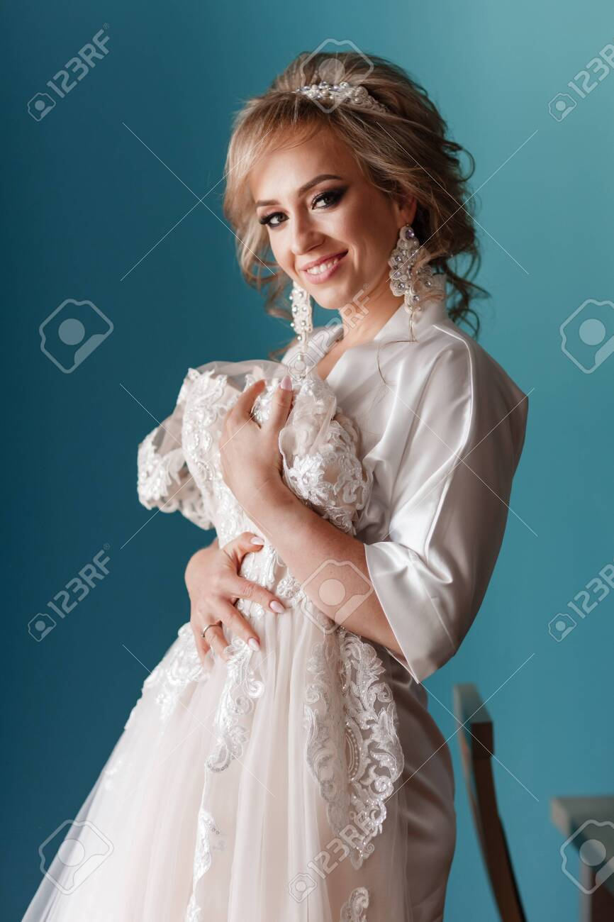 Bride Morning Preparation Happy Beautiful Young Woman In Silk Stock Photo Picture And Royalty Free Image Image 153318234