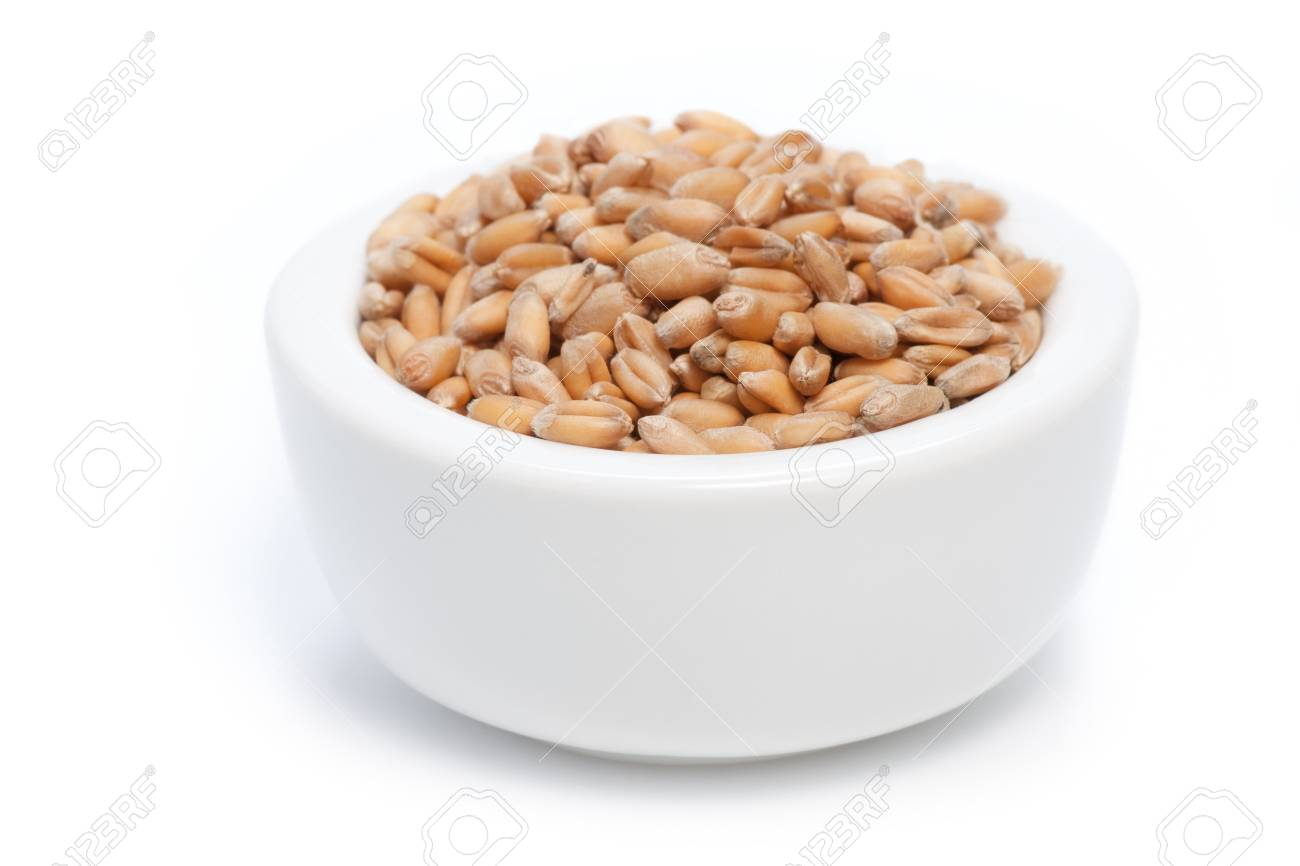 Seeds in a white bowl isolated on white background. Shallow depth of field. Stock Photo - 18332567