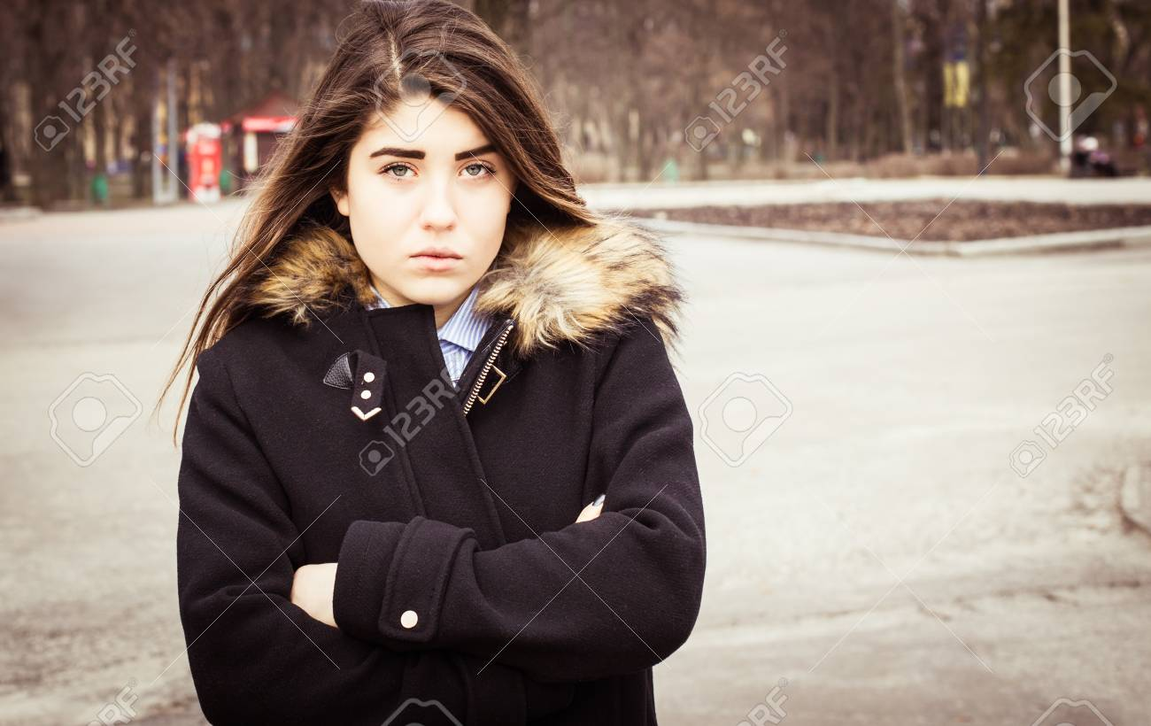 7ab147bb3d40 Outdoor portrait of a thoughtful teenage girl wearing a black coat. Stock  Photo - 66099226
