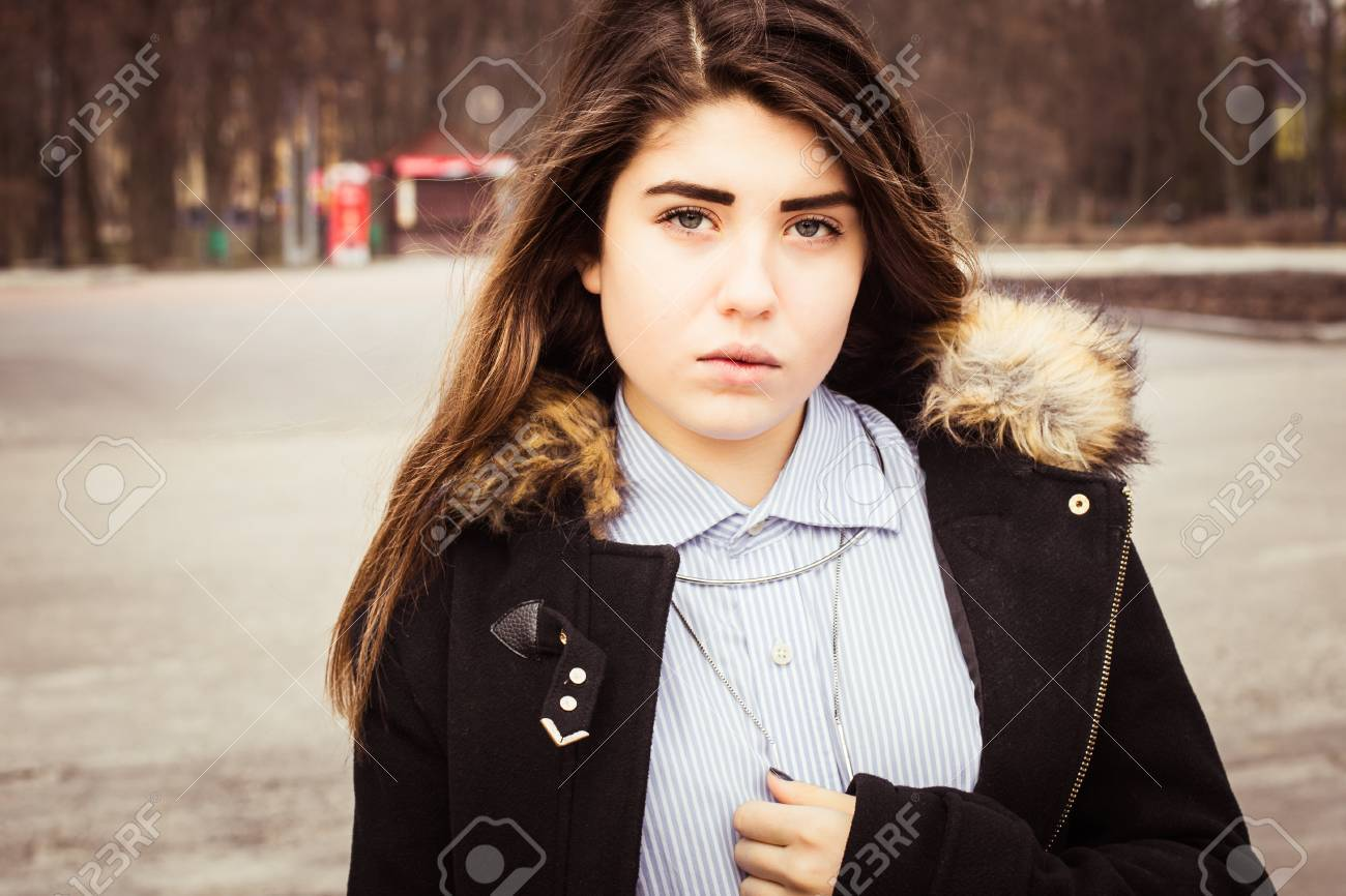 9184224ae167 Outdoor portrait of a thoughtful teenage girl wearing a black coat. Stock  Photo - 66099227