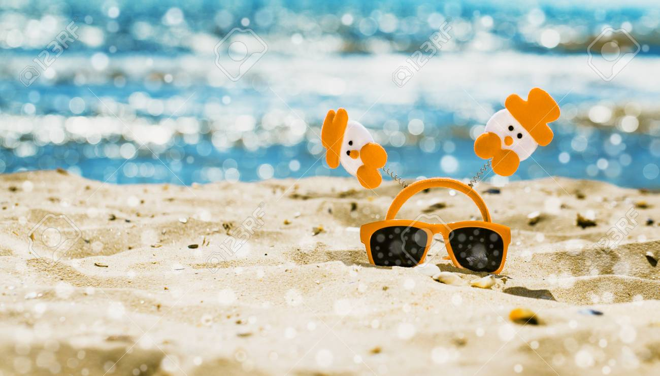 Funny Christmas Scene With Red Sunglasses On The Beach Vacation Stock Photo Picture And Royalty Free Image Image 92147620