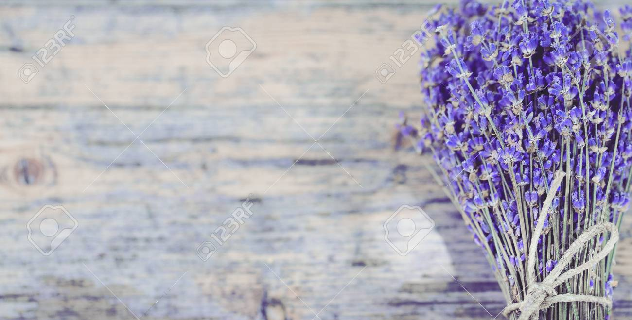 Bouquet Of Dried Lavender On An Old Painted Wooden Background Stock Photo Picture And Royalty Free Image Image 124694274