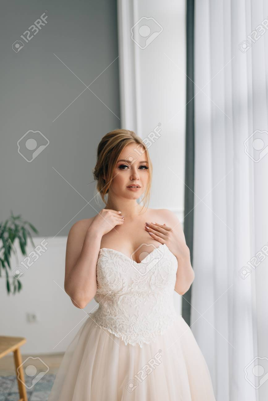 the bride with the big breast in a wedding dress dreams at the..