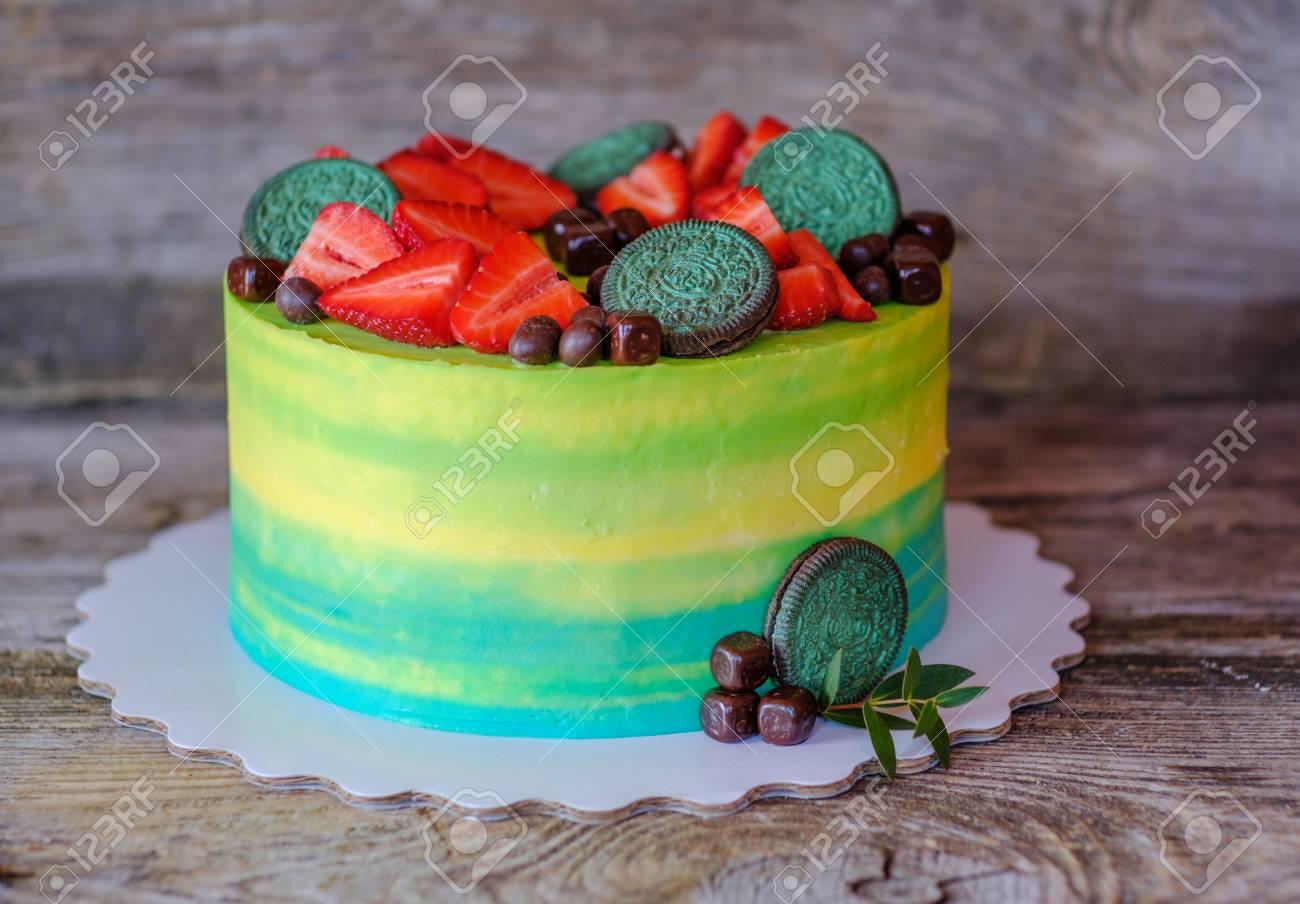 Beautiful Homemade Cake With Yellow And Green Cream Strawberry Berries Stock Photo